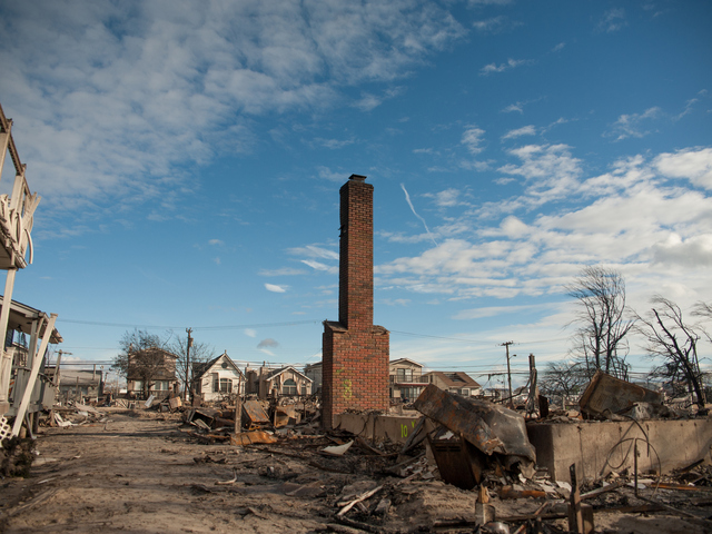<p>One of a few surviving chimneys stands tall amidst the rubble in Breezy point the day after Hurricane Sandy.</p>