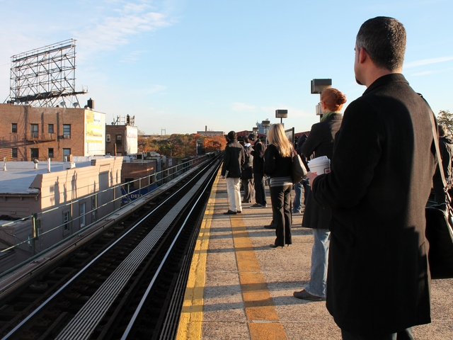 <p>Commuters wait for the N train at Astoria Boulevard in Queens on Thursday, as some subway lines resumed service for the first time since shutting down on Sunday before Hurricane Sandy.</p>