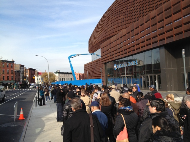 <p>Commuters brave long lines at the Barclays Center waiting for a bus into Manhattan on November 1, 2012.</p>