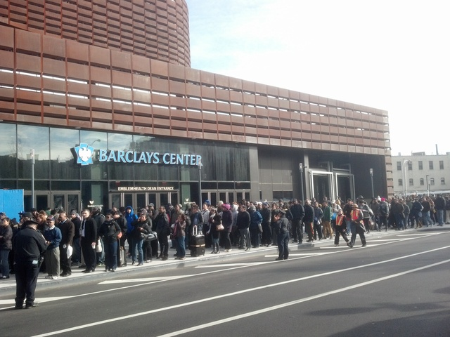 <p>Commuters brave long lines at the Barclays Center waiting for a bus into Manhattan on November 1, 2012. As the city resumes transportation services, straphangers are reporting long waits.</p>