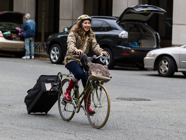 <p>A bicyclist evacuates Battery Park City on her bike readying for Hurricane Sandy, on October 28, 2012.</p>