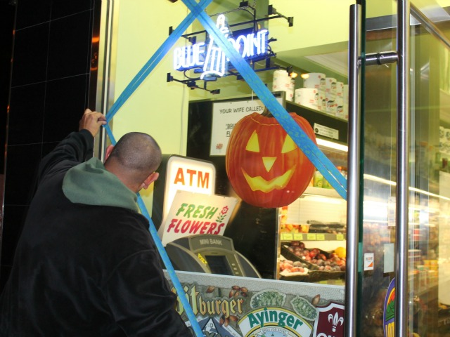 <p>Staff used blue tape to try to protect windows from flying objects head of Hurricane Sandy.</p>