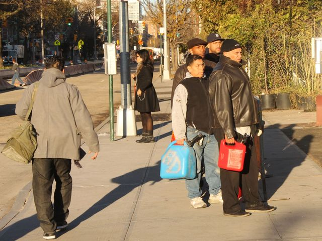 <p>New Yorkers lined up early Friday morning, Nov. 9, 2012, to fill their cans with gas at the Mobil Station at East Houston Street and Avenue C.</p>
