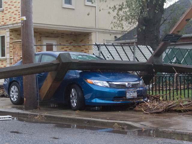 <p>Winds from Hurricane Sandy battered a Cedar Grove Avenue car with debris, leaving it wrecked on Tuesday October 30, 2012.&nbsp;</p>