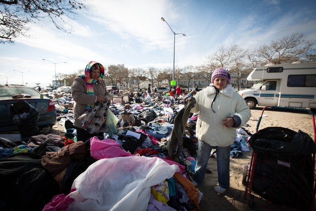 <p>Carmen Nunoz (R), 59, was looking for some warm clothes by Beach 94th street on Nov. 5, 2012 after Hurricane Sandy. Nunoz had to wear five light jackets and a puffy coat to keep warm.&nbsp;</p>