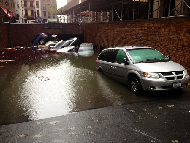 <p>Cars sit partially submerged near 17 South William St. in Lower Manhattan on Oct. 30, 2012 after Hurricane Sandy ripped through the city.</p>