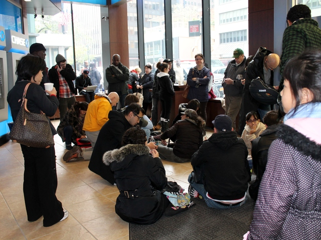 <p>Dozens of residents without power in lower Manhattan crowded into the lobby of the Chase Bank on Third Avenue and 41st Street Wednesday in search of outlets to charge their cell phones and laptops.</p>