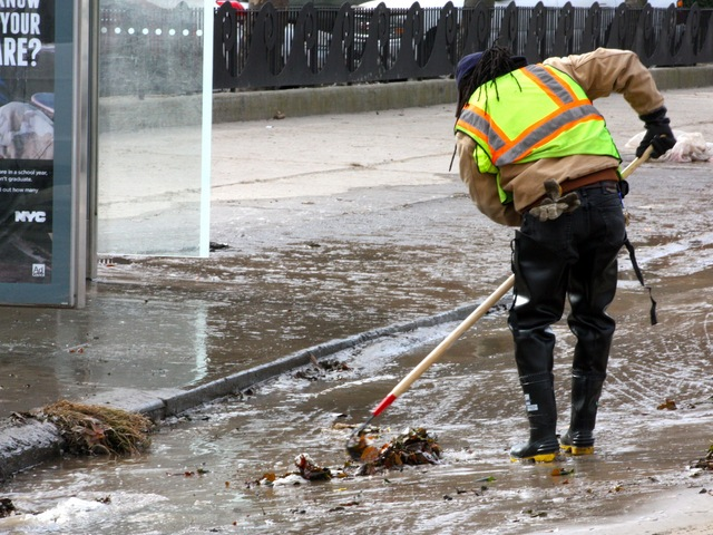 <p>Clean-up crews in Coney Island after Hurricane Sandy.</p>