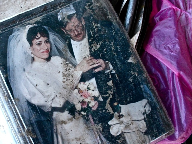 <p>November 6, 2012 - A muddy wedding photo sits at the top of a cardboard box in Sea Gate.</p>
