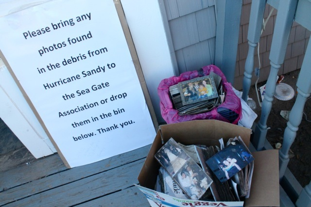 <p>November 6, 2012 -Smiling faces from shots of weddings, baptisms, graduations and family vacations sit in cardboard boxes near a sign that reads &quot;Please bring any photographs found in the debris of Hurricane Sandy to the Sea Gate Association or drop them in the bin.&quot;</p>