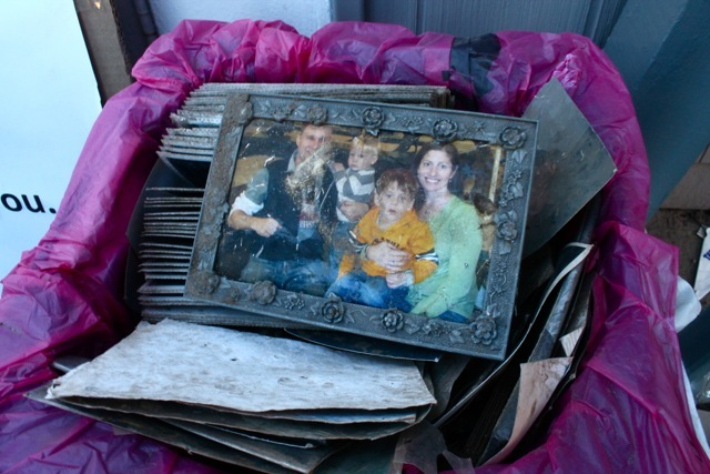 <p>November 6, 2012 - A family photograph sat in a cardboard box outside the Sea Gate chapel.</p>