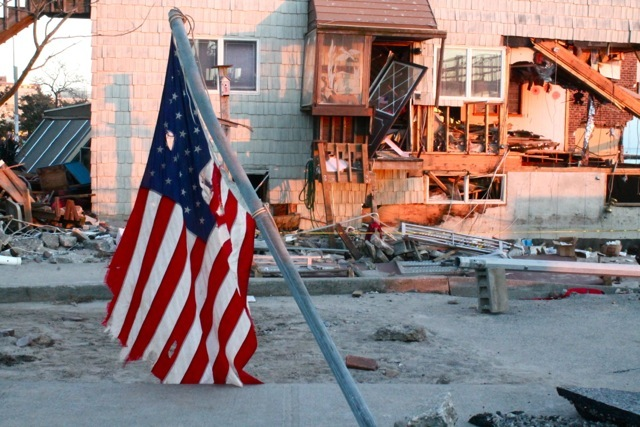 <p>November 6, 2012 - A flag flies near a damaged home in Sea Gate.</p>