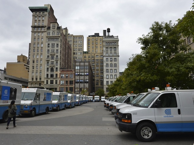 <p>Con Ed trucks staged in a parking lot ahead of Hurricane Sandy.</p>