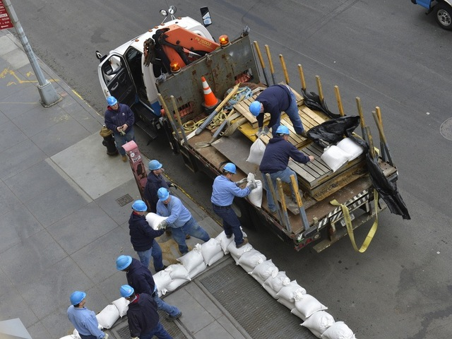 <p>Con Ed workers sandbag a facility ahead of Hurricane Sandy.</p>