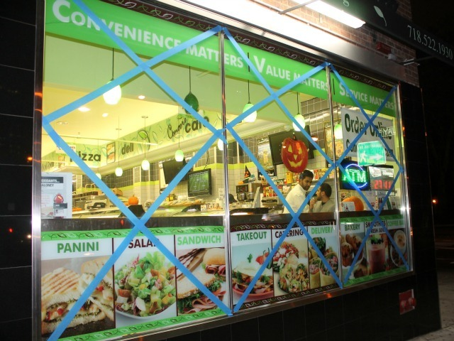 <p>Staffers used blue tape to try to protect windows at the Concord Market in Downtown Brooklyn.</p>