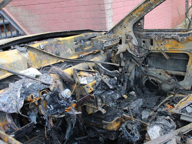 <p>The remains of a burnt-out car in Sea Gate after Hurricane Sandy.</p>