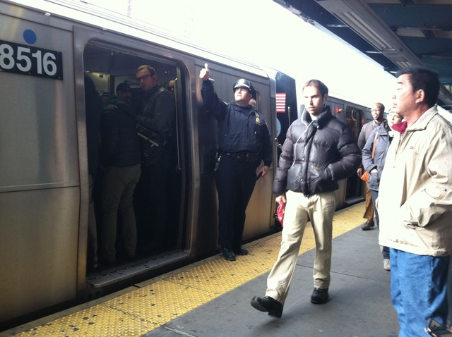 <p>A police officer helped control the crowd at a crowded subway stop Monday, Nov. 5, 2012, one week after Hurricane Sandy crippled New York City&#39;s mass transit system.</p>