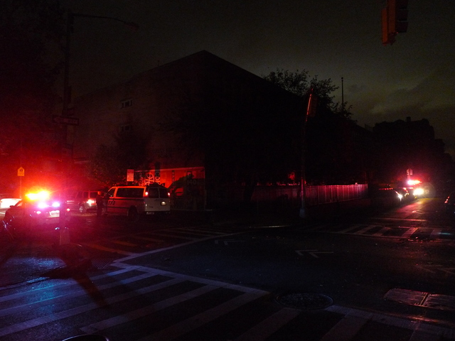 <p>The flashing lights of NYPD patrol cars were some of the few lights on the Lower East Side after Hurricane Sandy knocked out power.</p>