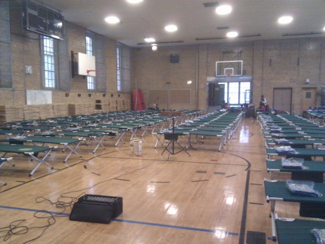 <p>An emergency shelter at Seward Park High School on the Lower East Side set up dozens of cots in preparation for Hurricane Sandy, Oct. 28, 2012.</p>