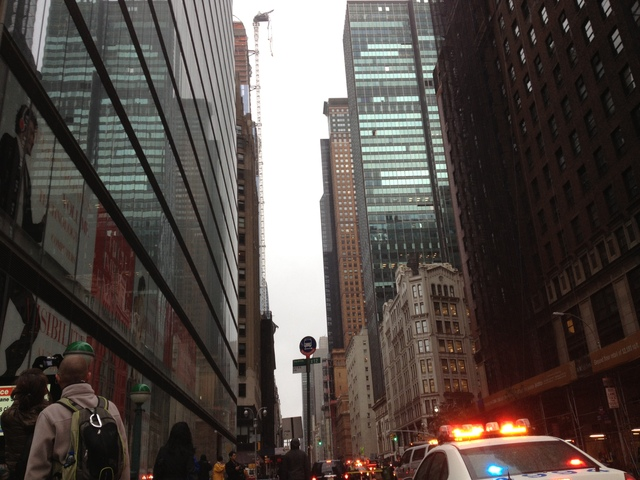 <p>People on the street stopped to stare at the crane hanging over West 57th Street between Sixth and Seventh avenues on Monday, Oct. 29, 2012.</p>
