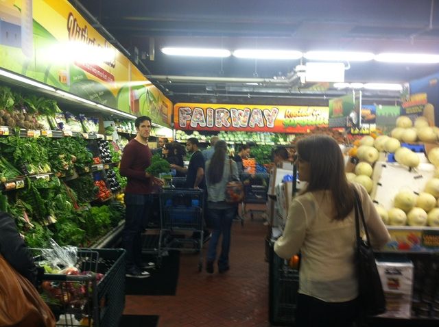 <p>Customers grabbed necessities and food at Fairway on October 27, 2012.</p>
