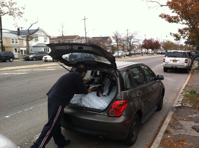 <p>Broad Channel resident Mike DelPino packs up his station wagon. He and his family are seeking temporary refuge on central Long Island on October 28, 2012.</p>