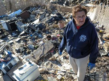 """My roof is in that field over there,"" said one resident sorting through the remains of his home."