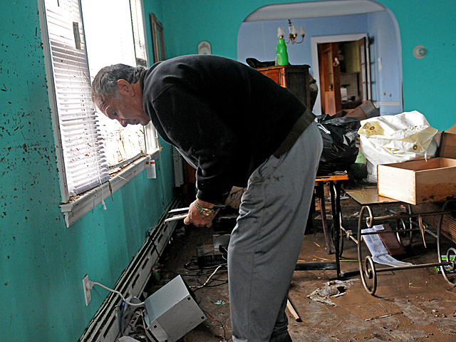 <p>Don Hallihan, 55, cleaned out his Staten Island home on Fox Beach Avenue after it was flooded during Hurricane Sandy on Oct. 31, 2012.</p>