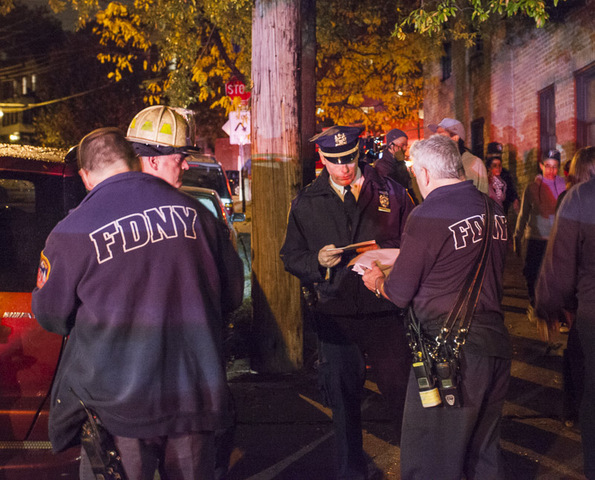 <p>Fire officials gathered at the scene of a double murder on Oct. 25, 2012.</p>