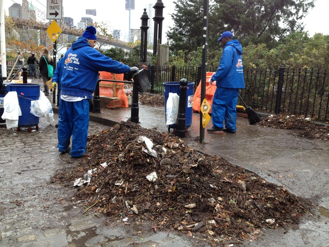 <p>People began to sweep up debris and leaves from the storm in DUMBO on Oct. 30.</p>