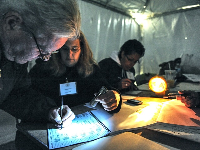 <p>Because of Hurricane Sandy-prompted power outages, volunteers on Staten Island had to work in the dark and cold on Election Day on Nov. 6, 2012.</p>