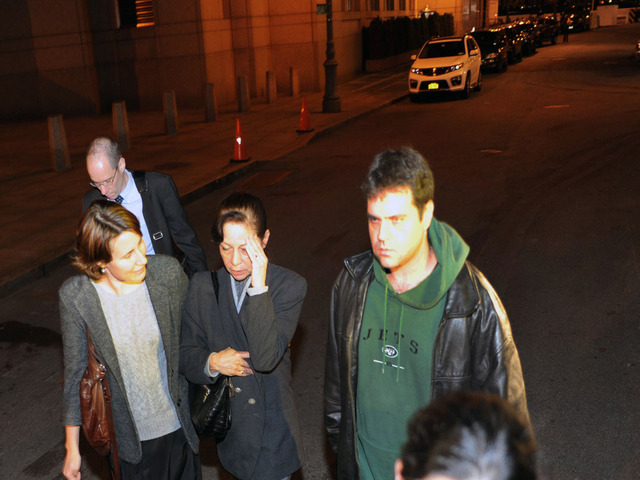 <p>Elizabeth Valle, mother of NYPD cop Gilberto Valle, with two other sons, left Gilberto Valle&#39;s arraignment Oct. 25, 2012.</p>