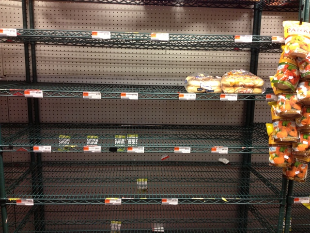 <p>Empty bread shelves at the Fairway market in Red Hook Sunday.</p>