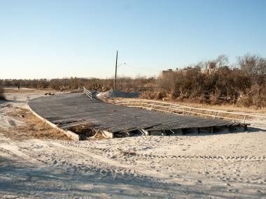 A large section of the boardwalk on Nov. 6, 2012, deposited further inland by Hurricane Sandy. Now the Army Corps of Engineers plans to restore Sandy-hit beaches by next year.