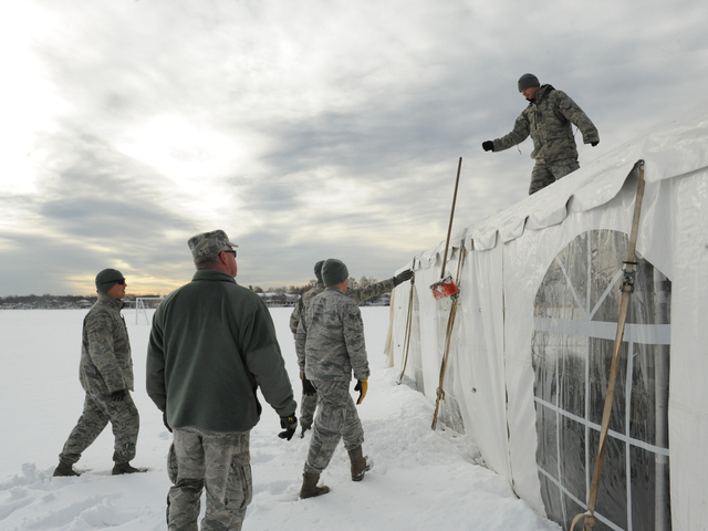 <p>National Guard cleans off the FEMA tent in Miller Field in Staten Island</p>