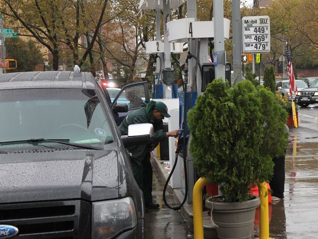 <p>A man fills up his car with gas Wednesday afternoon.</p>