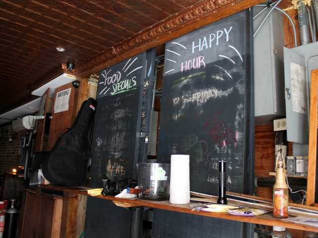 <p>The specials chalkboard at the Fishmarket Restaurant show how high the water flooded during Monday&#39;s storm. Owner Andy Oh said it was over seven feet.</p>
