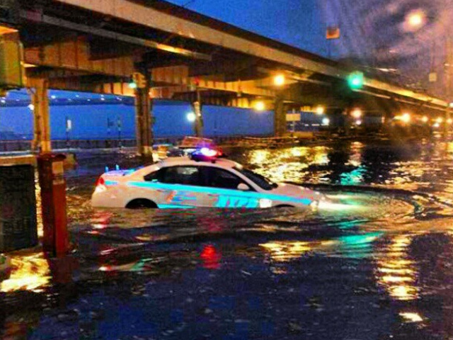 <p>A police car partially submerged near the East River during Hurricane Sandy on Monday, Oct. 29, 2012.</p>