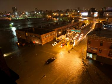 The Clock Bar at Bruckner Blvd. and Lincoln Ave. remained open as floodwaters surged from the Harlem River.