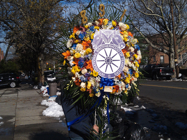<p>A flower arrangement from the International Brotherhood of Teamsters was readied for the Thursday, Nov. 8, 2012.,wake for Brendan and Connor Moore, 2 and 4, who died during Hurricane Sandy.</p>