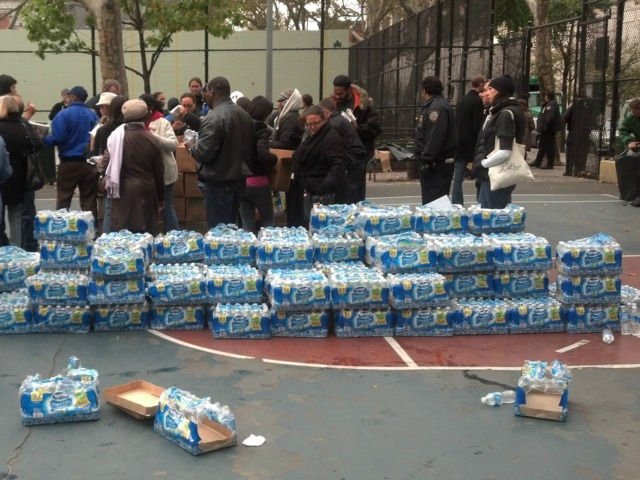<p>Cases of bottled water at Chelsea Park on West 27th&nbsp;Street.</p>