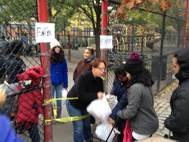 <p>Locals gathered at a playground on East 10th Street near Avenue D to pick up free meals and bottled water on Thursday, Nov. 1, 2012.</p>