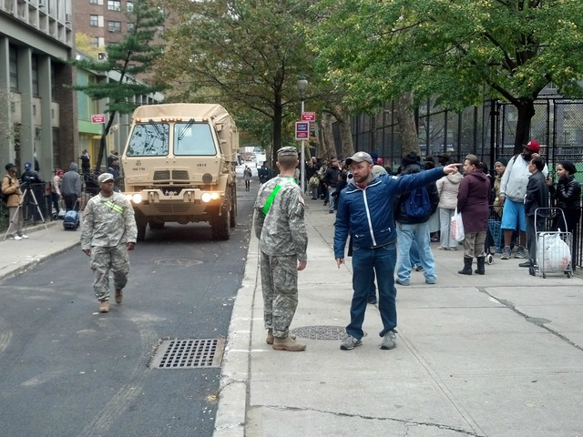 <p>A National Guardsman talks with City Council candidate Corey Johnson at Chelsea Park.</p>