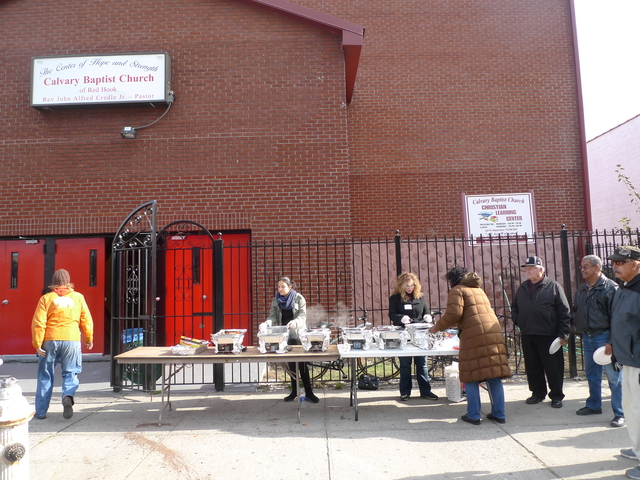 <p>A food line distributes hot meals to Red Hook Houses residents, many of whom have been without power, heat, hot water and elevator service since Hurricane Sandy flooded the neighborhood.</p>