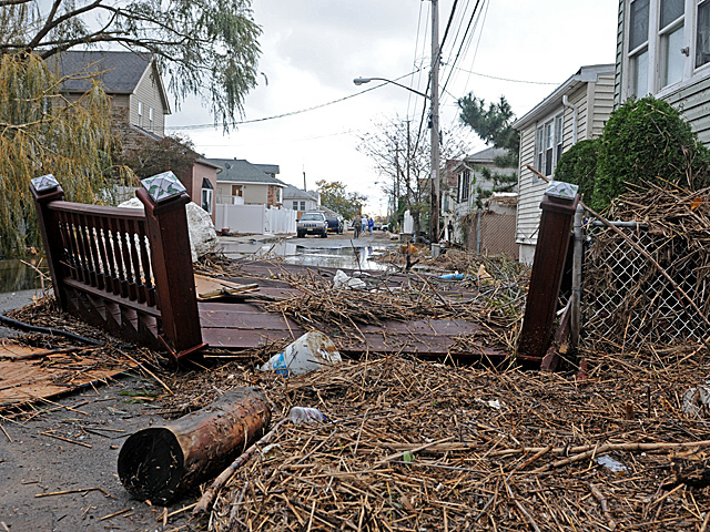 <p>Parts of homes littered Fox Beach Avenue, Staten Island, a day after Hurricane Sandy, Oct. 31, 2012.</p>