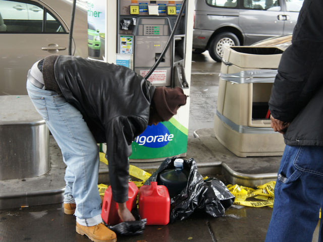 <p>A man fills up a gas can at a BP gas station at Bedford and Lincoln Place in Crown Heights.&nbsp;</p>