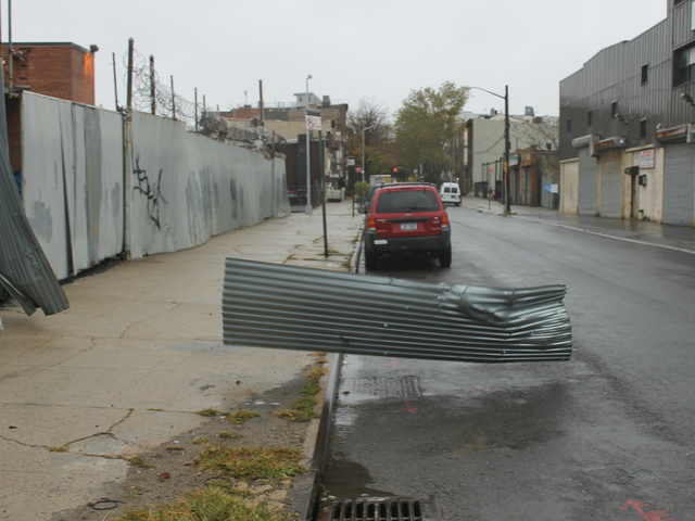 <p>Winds from Hurricane Sandy blew corrugated metal off the fence outside a Verizon building on Carroll Street in Gowanus.</p>