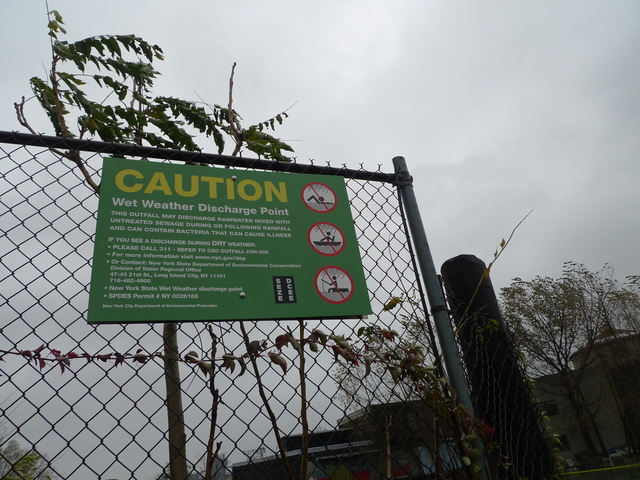 <p>A sign near the Gowanus Canal warning the water rises during storms.</p>
