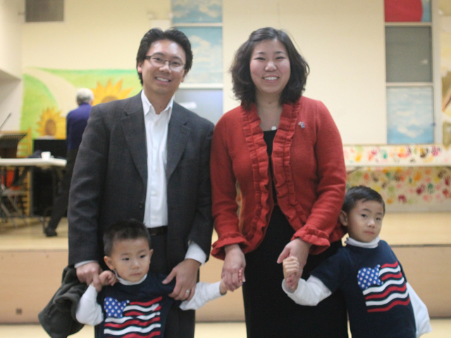 <p>Assemblywoman Grace Meng made an appearance at the Koren Community Services Senior Center in Flushing on Nov. 6, accompanied by her husband Wayne and her sons Brandon (left) and Tyler (right).</p>