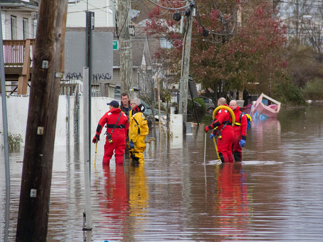 <p>Rescue workers search the homes on Grimsby Avenue, Staten Island, after Hurricane Sandy. Two elderly woman were found dead in their home on Grimsby Avenue, Oct. 31, 2012.</p>